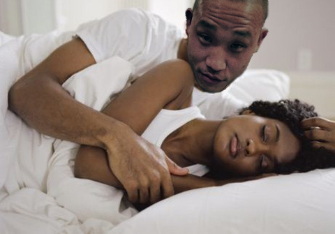 Blackcoupleinbed